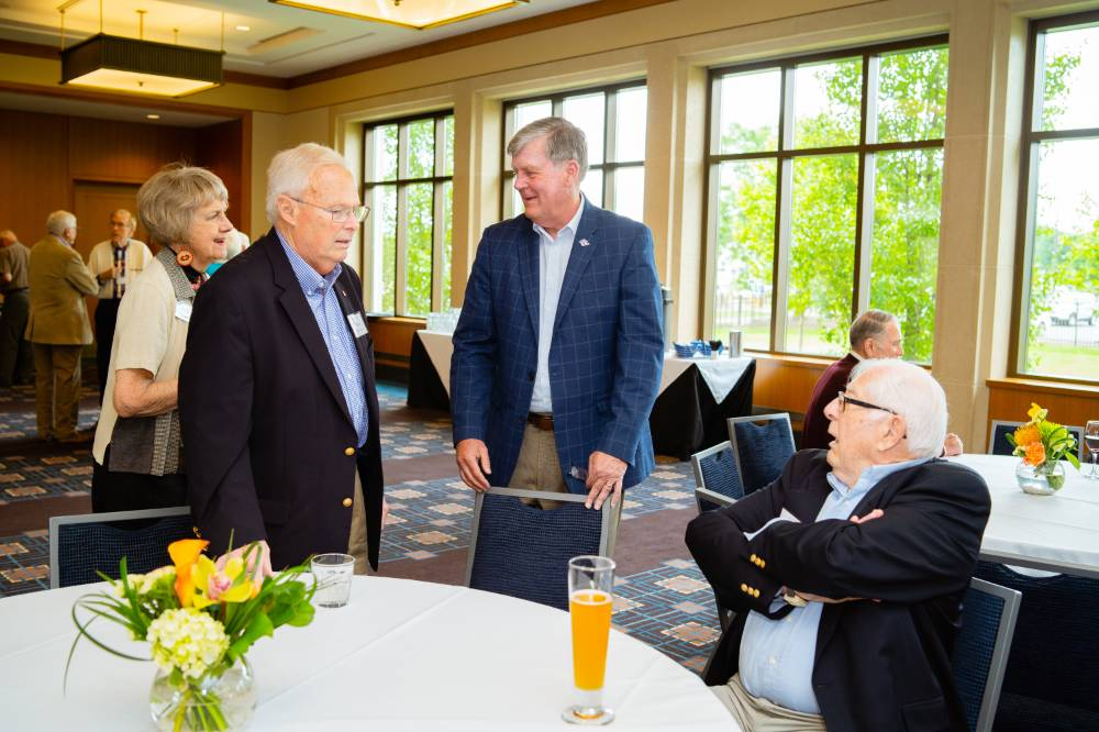 President Haas visiting with guests at the Retiree Reception.