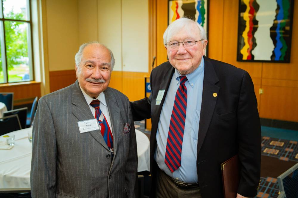 President Emeritus Don Lubbers posing with Samir Ishak at the Retiree Reception.