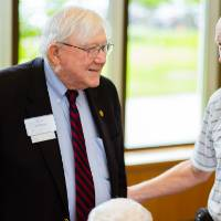President Emeritus Don Lubbers talking with guests at the Retiree Reception.