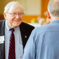 President Emeritus Don Lubbers talking with a guest at the Retiree Reception.