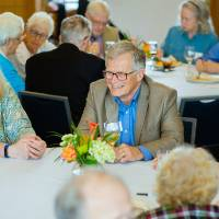 Guests mingling at the Retiree Reception.