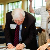 President Emeritus Don and Nancy Lubbers looking at books at the Retiree Reception.