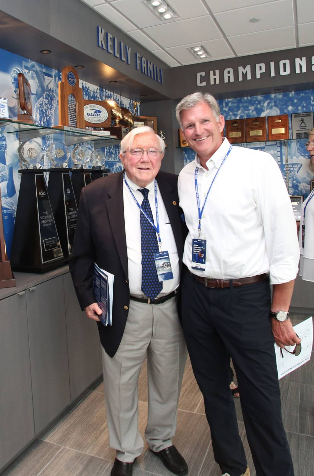 President Emeritus Don Lubbers posing with Randy Damstra at the Jamie Hosford Football Center dedication.