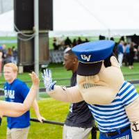 Louie the Laker giving a guest a high-five at the Jamie Hosford Football Center dedication.