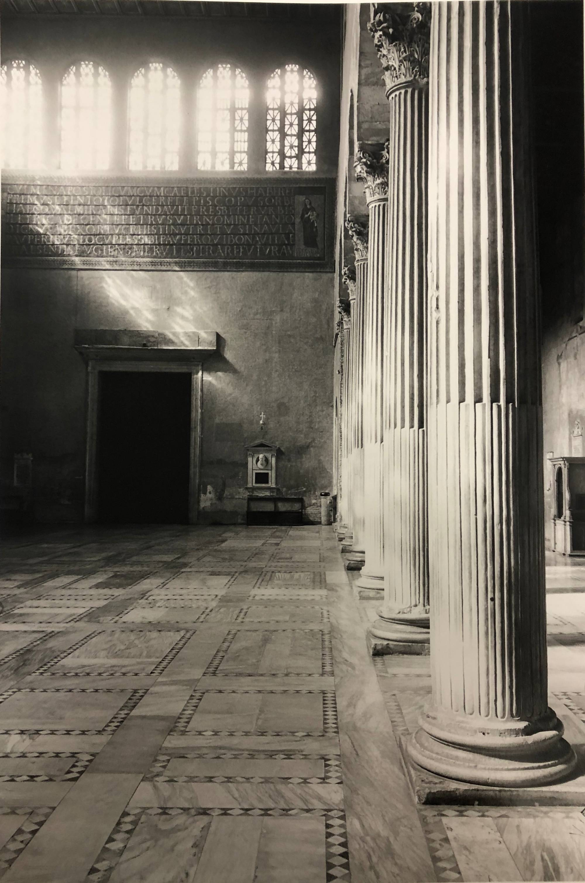 black and white photo of white columns inside cathedral