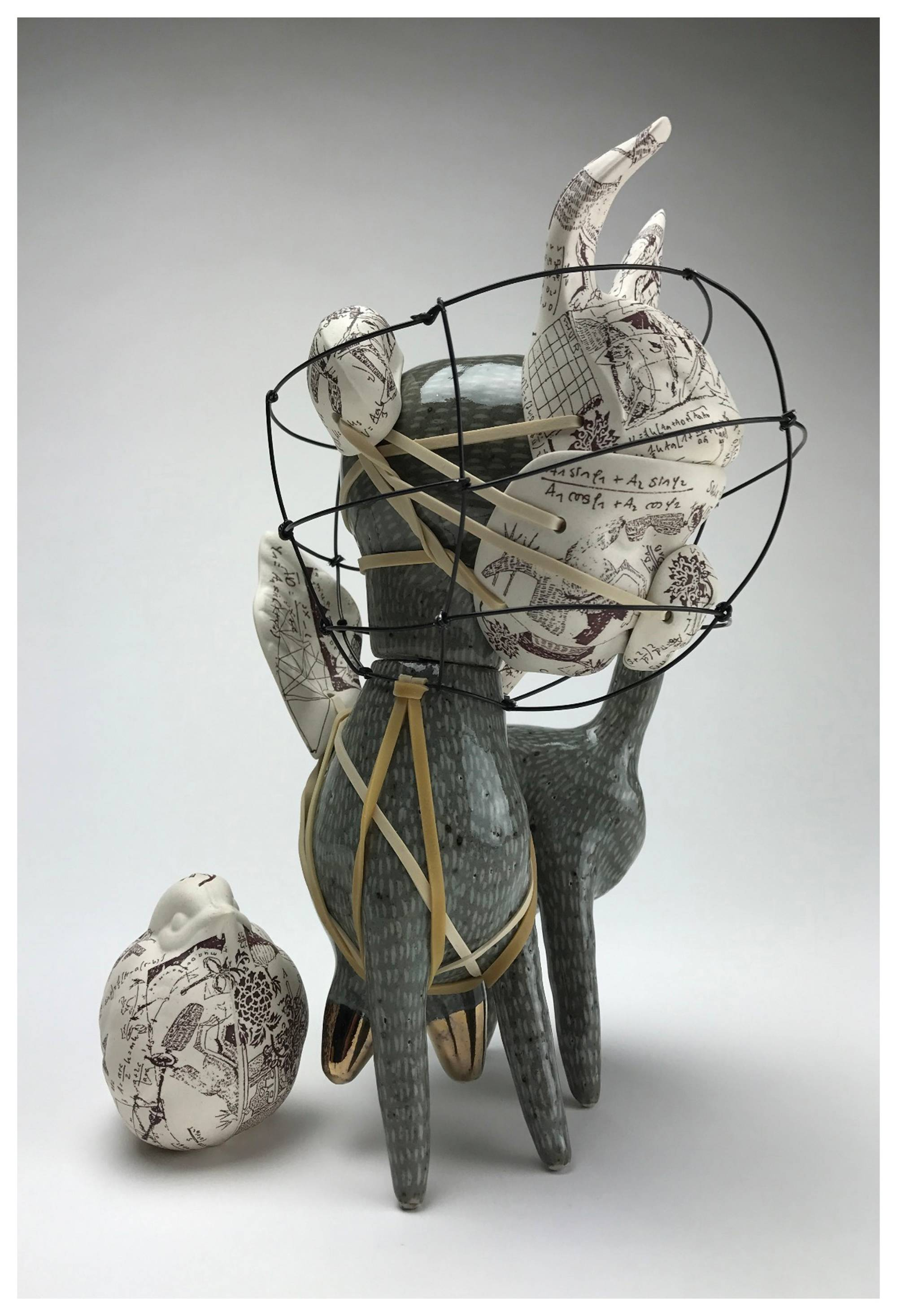 Ceramic Dog with wire cone around head