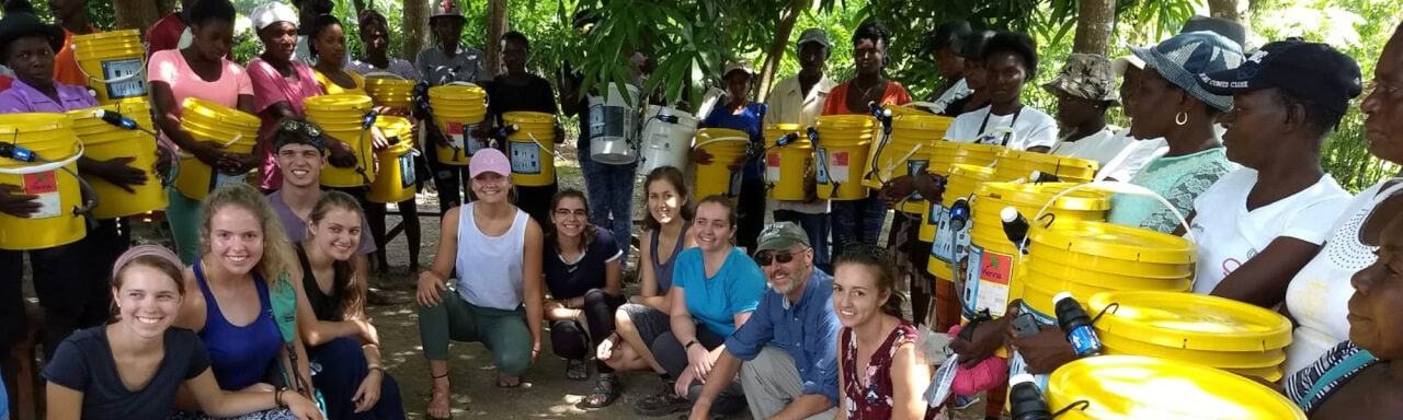 Group of GVSU travelers with local Haitians