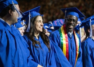 Students wearing blue regalia at Commencement ceremony (photo)