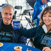 Alumni raise a glass to Homecoming while enjoying delicious food