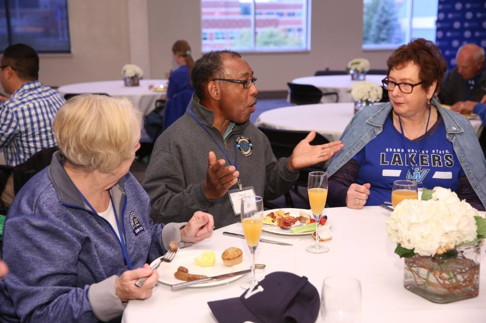 3 Alumni enjoy conversation at brunch