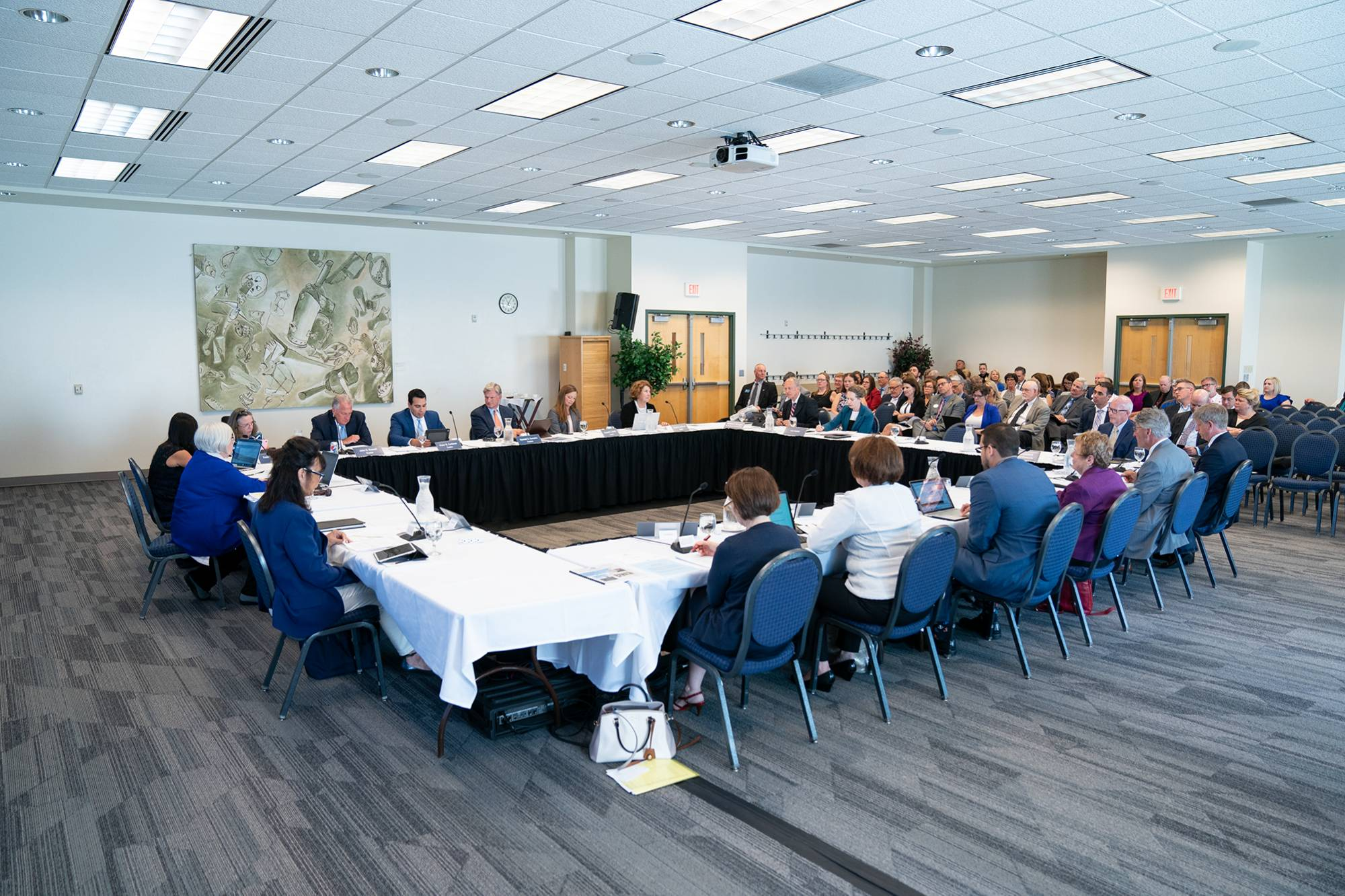The Board of Trustees meets during a July 2019 meeting