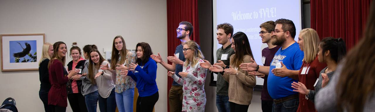 First Year Leadership Experience participants clapping.