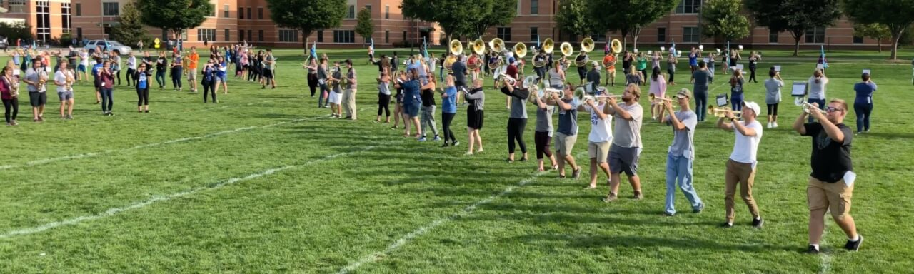 The Laker Marching Band marching at ArtPrize, rehearsing drill and pregame