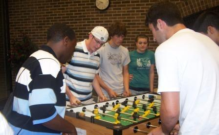 6 GVSU students playing Foosball