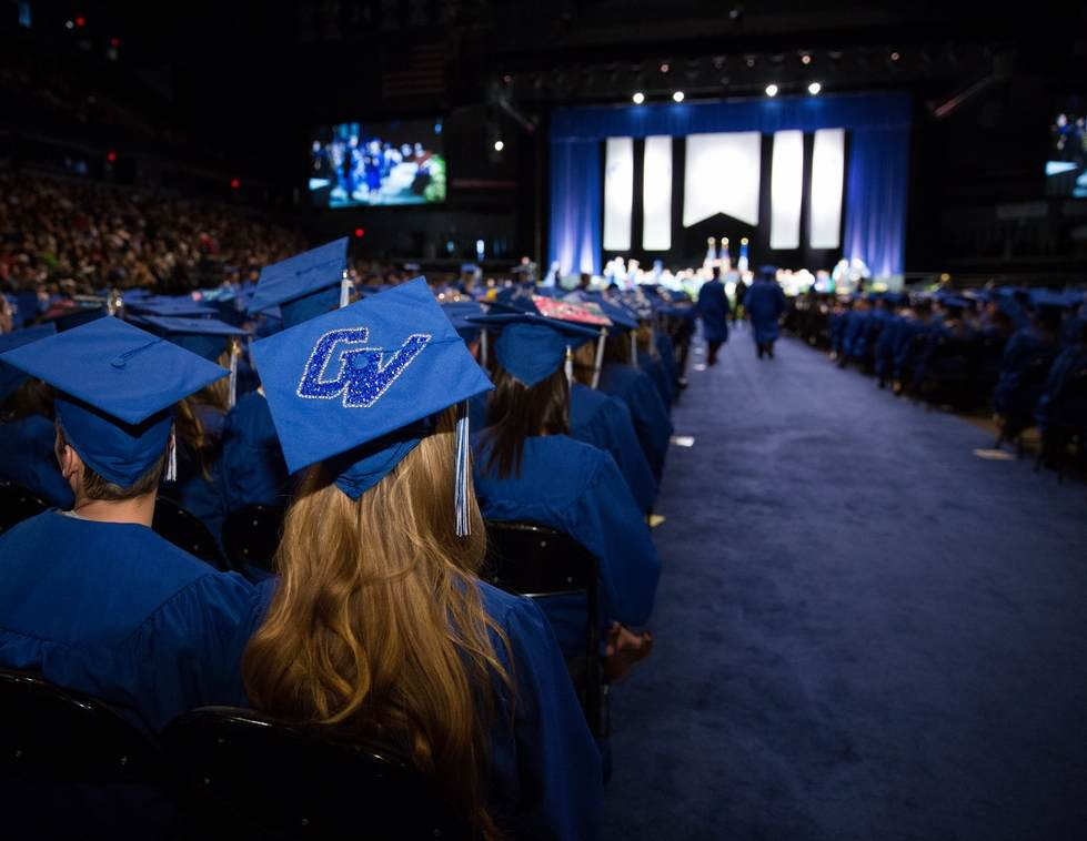Students at commencement, a graduation cap has the GV logo