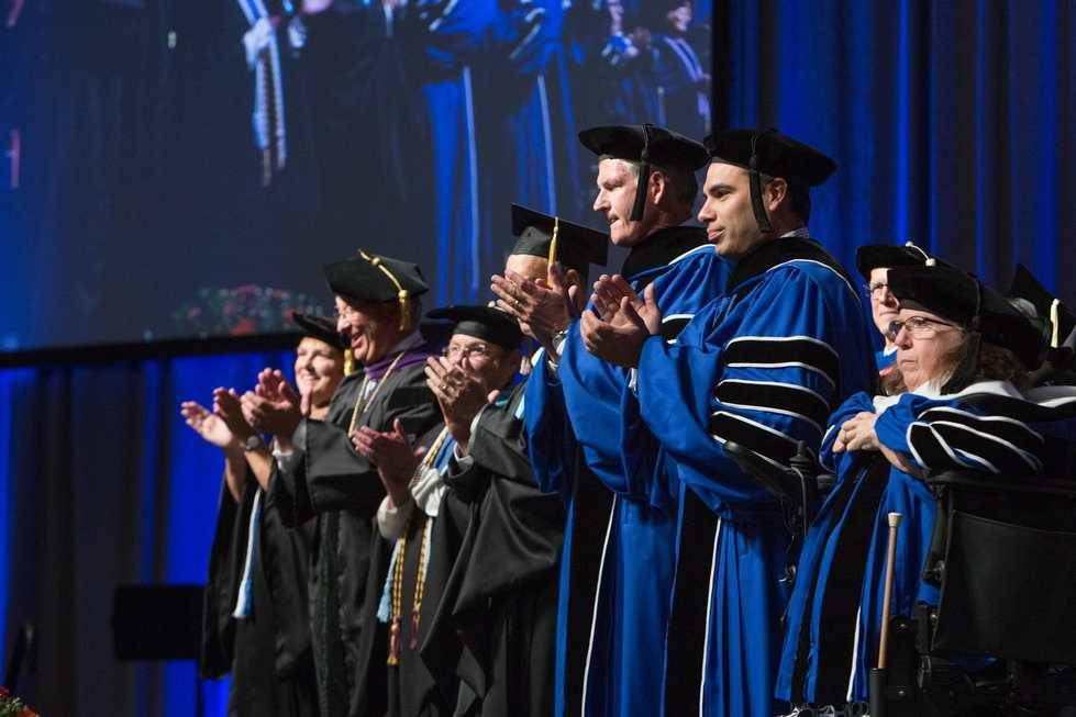 Faculty at Convocation Ceremony dressed in caps and gowns