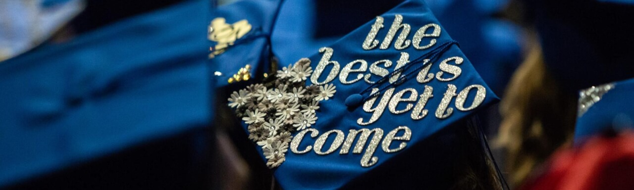 "A student's graduation cap reads ""The best is yet to come"""