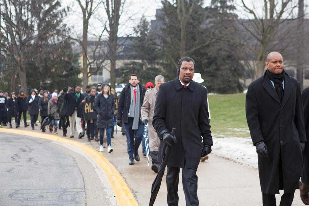 people marching on campus