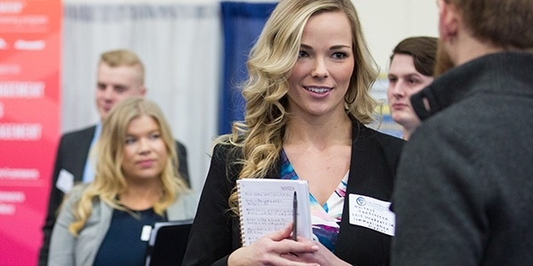 Female student at career fair.