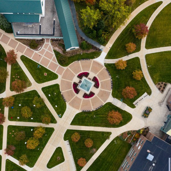 Drone photo of Allendale campus with clock tower at center and lots of sidewalks