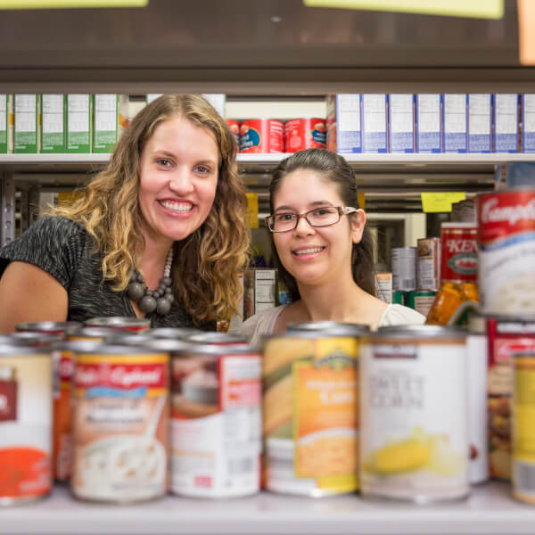 Alumnae Rachael DeWitt, left, and Susana Villagomez-Barajas founded the student food pantry and returned September 22 to celebrate its new location in Kirkhof Center.