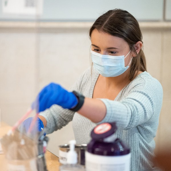 A student helping at a GVSU testing clinic on campus.