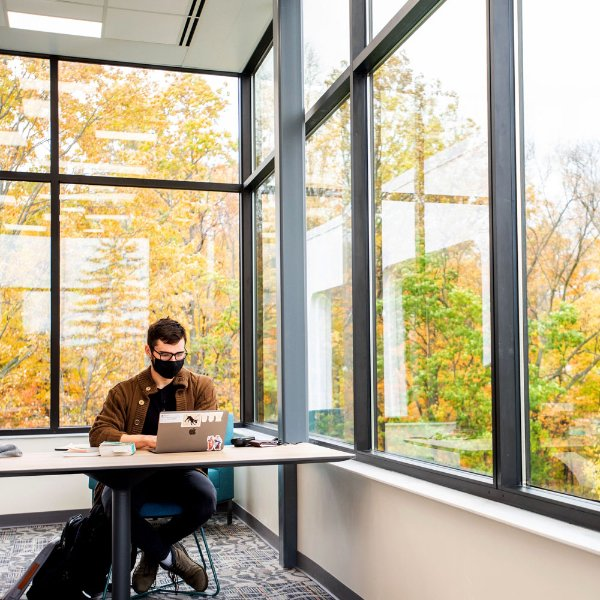 A student studying in a newly renovated area of Lake Huron Hall.