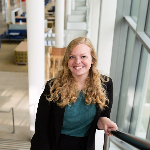 A portrait of Caroline Murray in GVSU's Mary Idema Pew Library on the Allendale Campus