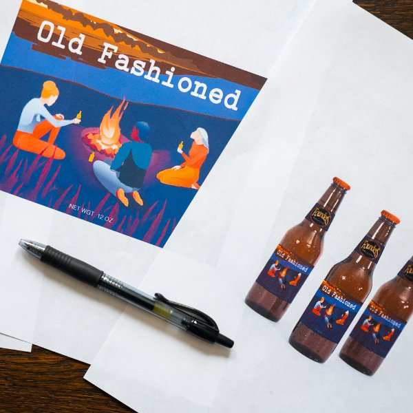 illustrations of a beer bottle label, says Old Fashioned and has illustrated people around a campfire