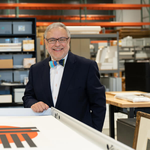 Henry Matthews, who has a new position in University Development, stands by the print and drawing cabinet in the art storage room, located in the Innovation Design Center. There are 9,000 pieces of artwork stored in the building on Winter Street.