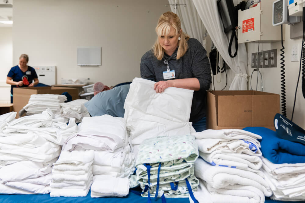 woman unpacking linens