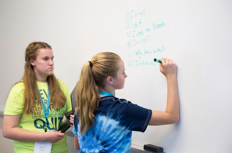 two students at whiteboard