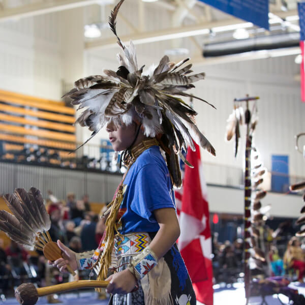 A photo of a person participating in the annual Pow Wow at Grand Valley.