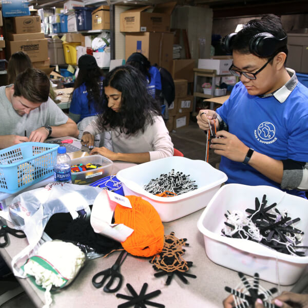 Students make Halloween crafts at the Grand Rapids Children's Museum.