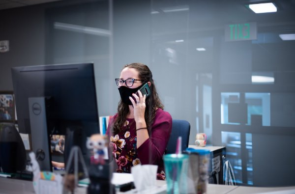 Marion Mathisen, assistant to the associate vice president of Institutional Marketing at GVSU, responds to a caller as a GVSU COVID-19 Call Center volunteer.