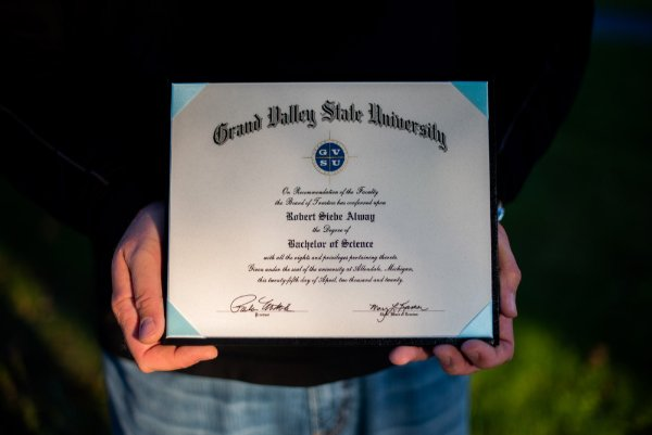 hands holding a diploma