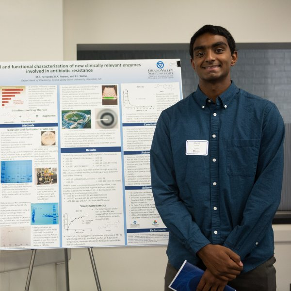 Micah Fernando pictured in front of his research poster
