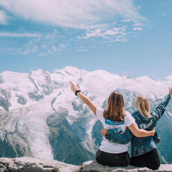 A finalist in the PIC Pics competition submitted by Valerie Wojciechowski featuring two students sitting on top of a mountain.