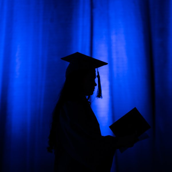 Silhouette of a graduate at the Laker Graduation Celebration