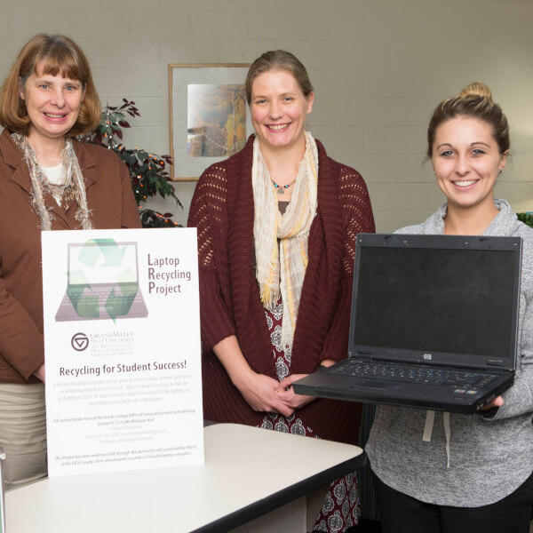 From left to right are Anita Benes, Jennifer Jameslyn and graduate assistant Emily Smigiel. The Integrative Learning and Advising office has established a laptop loan program.