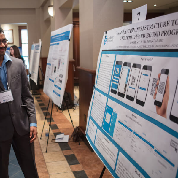 A graduate student explains his research at the 2017 Grad Showcase.