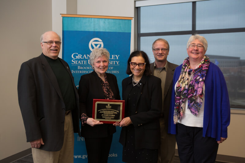 Jo Ellyn Clarey, second from right, is the Kutsche Office of Local History's Gordon Olson Award recipient, recognizing her work with the Greater Grand Rapids Women's History Council. With Clarey are, from left, Gordon Olson, Peg Padnos, Robert McArdle and
