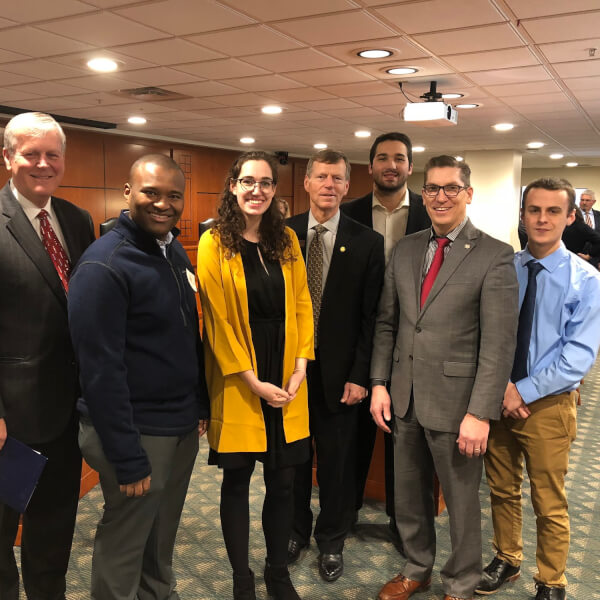 President Thomas J. Haas, far left, and Student Senate President Rachel Jenkin, third from left, testified before the Michigan House Subcommittee on Higher Education February 14.