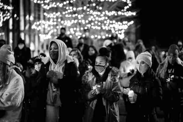 A black and white photo of people gathered for a candlelight vigil on GVSU's Allendale Campus held in memory of first-year student Taylor DeRosa.