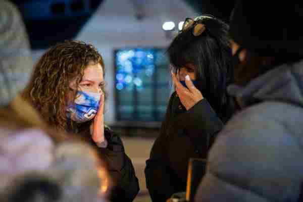 Taylor DeRosa's mother and GVSU President Philomena V. Mantella wipe away tears during a candlelight vigil held in Taylor's memory.