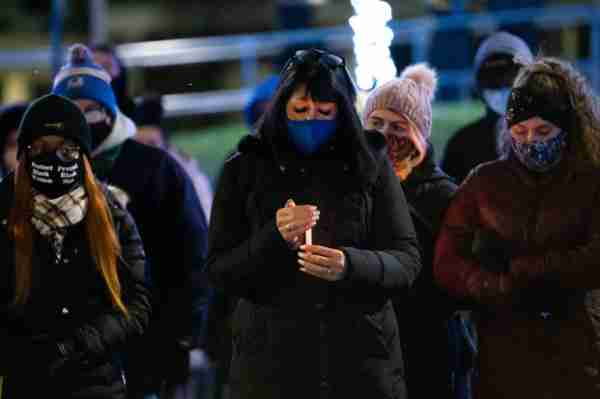 GVSU President Philomena V. Mantella with a lit candle during a vigil held in memory of first-year student Taylor DeRosa.