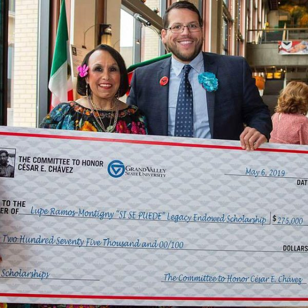 Lupe Ramos-Montigny, chair of the Committee to Honor César E. Chávez, and Jesse Bernal hold a big check at a previous Chavez community event.
