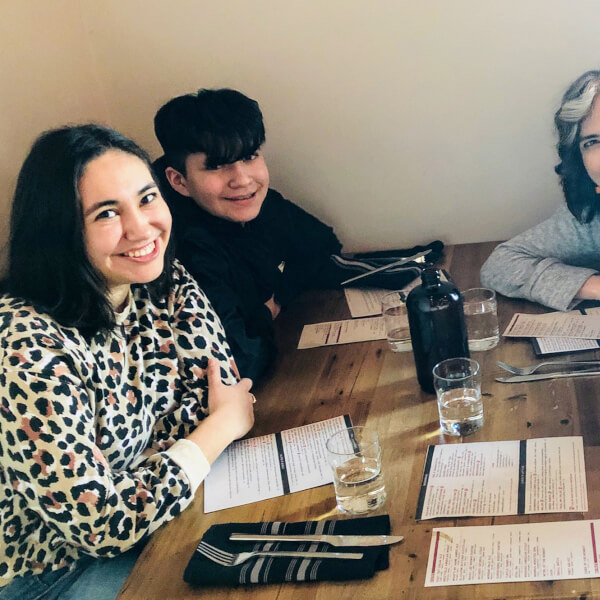 family of four at table in a restaurant