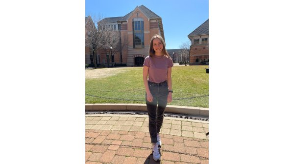 Jenna Stolzman standing on campus
