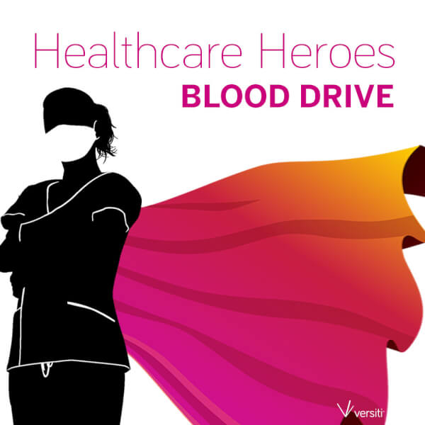 promotional image for blood drive showing masked health care worker with cape
